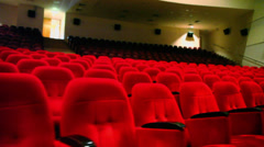 Concert auditorium with rows of comfortable red cloth seats Stock Footage