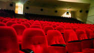 Stock Video Footage of Concert auditorium with rows of comfortable red cloth seats