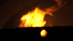 Hole Fire and Log Stock Footage