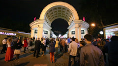 People stand near entrance of metro station before concert Stock Footage