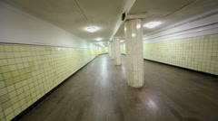 Lamps of illumination and columns in empty pedestrian tunnel Stock Footage