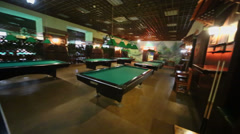 Many tables for billiard stand in empty poolroom Stock Footage