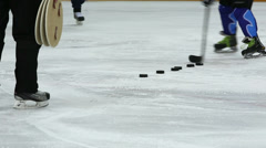 Hockey player throws few pucks to targets in gate Stock Footage