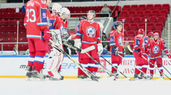 Red uniform hockey team stand in row on ice Stock Footage