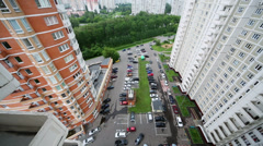 Car ride by parking on yard of tall dwelling houses Stock Footage