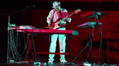 Andrey Klimkovsky plays on guitar during concert program Stock Footage