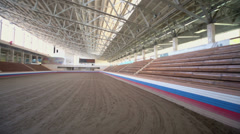 Under roof stadium with sand coated for horse racing Stock Footage