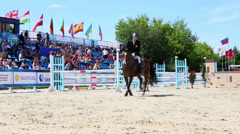 Horseman rides on horse near tribunes at competitions Stock Footage