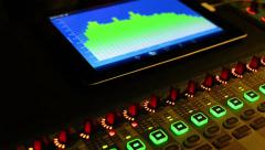 Music studio audio mixer with digital vu meter display showing audio waves. Stock Footage