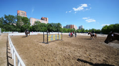 Athletes warm up at horses during tournament Stock Footage