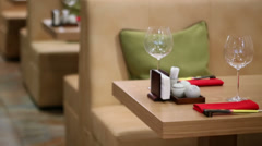 Empty glasses on tables and sofas in Japanese restaurant Stock Footage