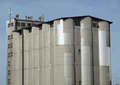 Big sheetmetal silo for grain storage - stock photo