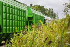 Train of freight wagons and tanks - stock photo