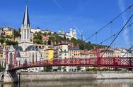 Stock Photo of view of lyon city and red footbridge