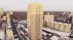 Beautiful aerial view of a city in winter during the day Stock Footage