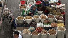 Selling nuts and dried fruit at bazaar, Silk Road market in Tajikistan Stock Footage