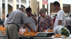 Family buying oranges at bazaar in Central Asia Stock Footage