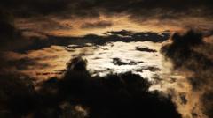 Sun behind dark clouds. Stock Footage