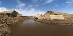 The collapsed dam after heavy floods - stock photo