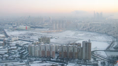 Sunset aerial view of a snowed city, timelapse Stock Footage