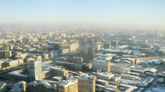 Aerial view of city bathed in sunlight in the morning, timelapse Stock Footage