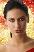 Woman in red and gold Stock Photos