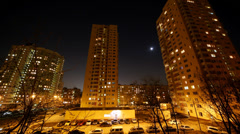 Moon moving on the sky above blocks, timelapse Stock Footage