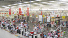Clients paying for their purchases at Auchan Stock Footage