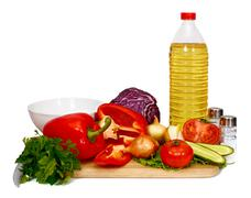 sunflower seed oil and vegetables for preparation of salad - stock photo