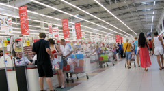 People traffic near cashier in mall at Auchan Stock Footage