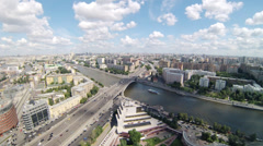 City view during day with traffic on bridge over river Stock Footage