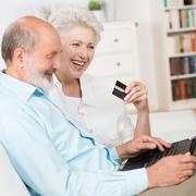 senior couple buying online - stock photo