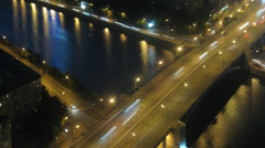 Illuminated bridge over river with traffic during the night Stock Footage