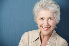 Beautiful elderly lady with a lively smile Stock Photos