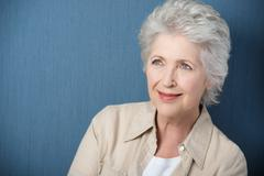 beautiful senior woman daydreaming - stock photo