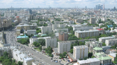 Aerial view of a city with lots of trees and traffic on street Stock Footage