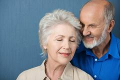 elderly couple share a tender moment - stock photo