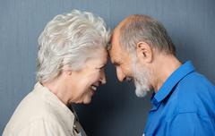 playful loving senior couple - stock photo