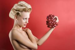 The blond with grape Stock Photos