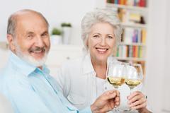 Happy senior couple toasting each other Stock Photos