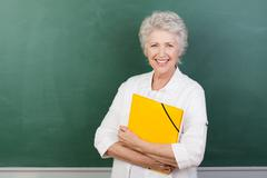 Caucaisna cheerful female senior teacher Stock Photos