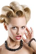 the blond making face - stock photo