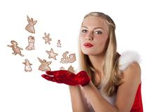 Christmas girl blowing cookies Stock Photos