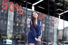 Beautiful young woman walking on the street Stock Photos