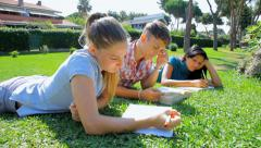 Student getting bored while studing with two girls Stock Footage