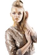 the sequin glittering creative make up girl, her hand is near the face - stock photo