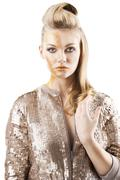 the sequin glittering creative make up girl, she is in front of the camera - stock photo