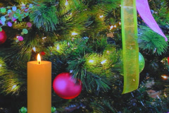 golden holiday candle with Christmas tree decorations - stock footage