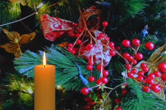Golden candle with red berries and decorations Stock Footage