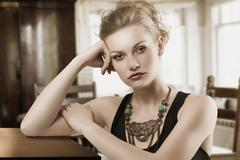 blond woman with necklace - stock photo